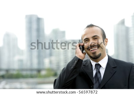Happy Hispanic business man on Phone - stock photo