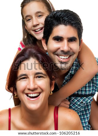 Happy hispanic family consisting of father,mother and daughter having fun together