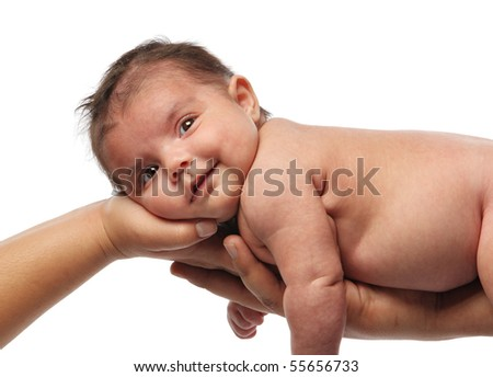 happy Hispanic newborn baby with very soft skin being held up by parent's outstretched arms - stock photo