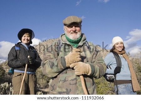 Happy hispanic woman with parents on hiking trip