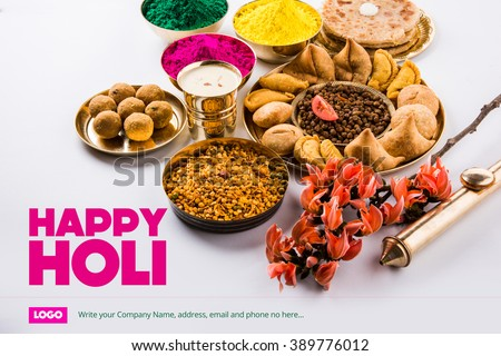 happy holi greeting card, holi wishes, greeting card of indian festival of colours called holi, season's greetings, indian festival greeting, indian food & colours arranged on ground for holi greeting - stock photo