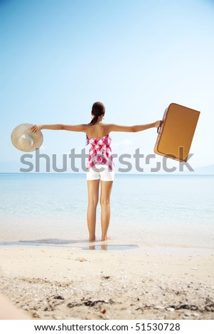 happy holiday maker arrives at destination - stock photo