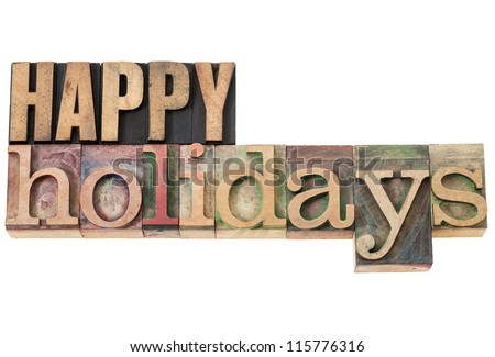 happy holidays - isolated text in vintage letterpress wood type - stock photo
