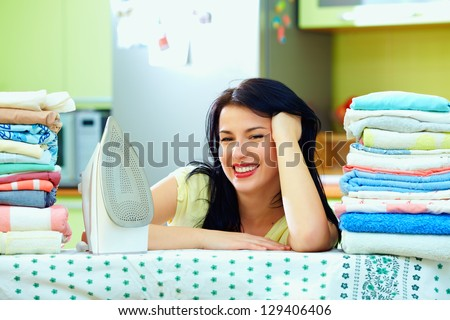 happy housewife completed ironing, home interior - stock photo