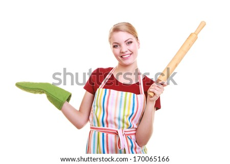 Happy housewife or baker chef wearing kitchen apron green oven mitten holds baking rolling pin showing empty copy space presenting with open hand palm isolated on white