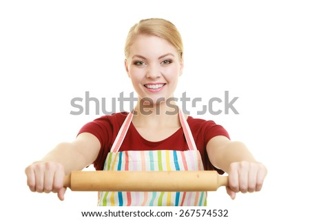 Happy housewife or baker chef wearing kitchen apron holds baking rolling pin studio picture isolated on white - stock photo