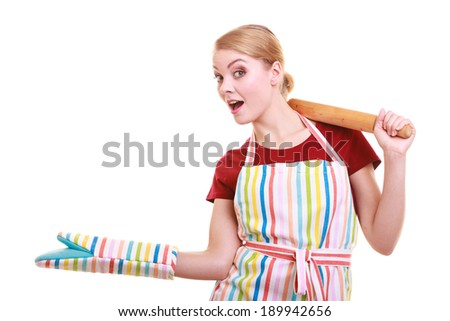 Happy housewife or baker chef wearing kitchen apron oven mitten holds baking rolling pin showing empty copy space presenting with open hand palm isolated on white