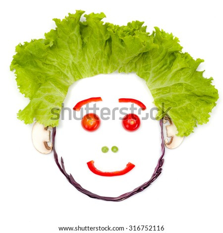 Happy human head made of vegetable pieces - stock photo