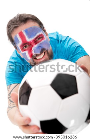 happy icelandic soccer fan with a football, isolated on white