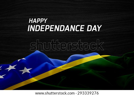 Happy Independence Day Solomon Islands flag and wood background