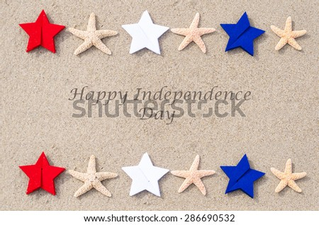 Happy Independence Day USA background with starfishes, red, blue and white stars on the sandy beach (4th of july holiday concept) - stock photo