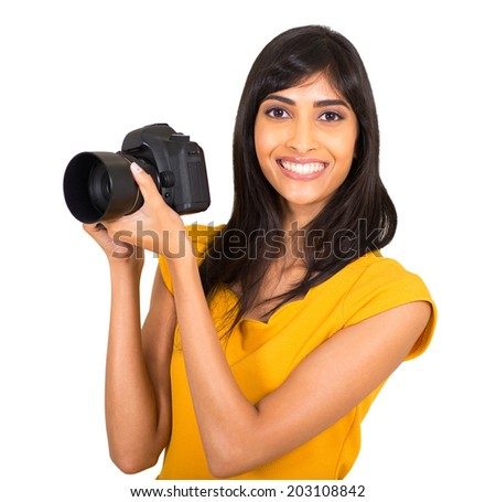 happy indian female photographer with a dslr camera - stock photo