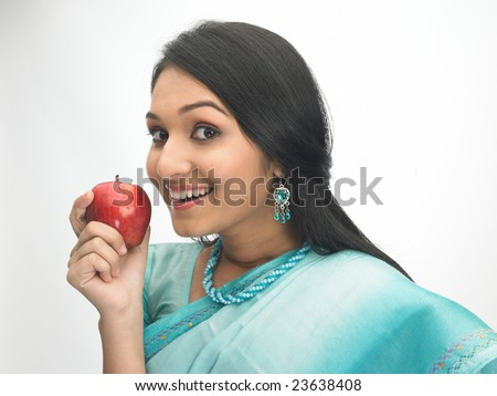Happy indian girl with the red apple - stock photo