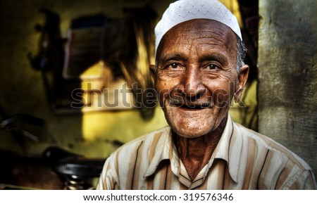 Happy Indian Man Smiling For The Camera Concept - stock photo