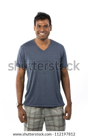 Happy Indian man wearing t-shirt & shorts. Isolated on White Background