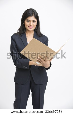 Happy Indian young business woman with document, isolated on white background - stock photo