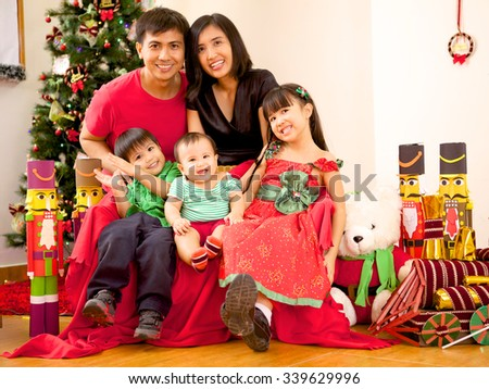 Happy Indonesian Family On Christmas - stock photo