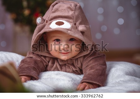 Happy infant baby boy in christmas decorations closeup - stock photo