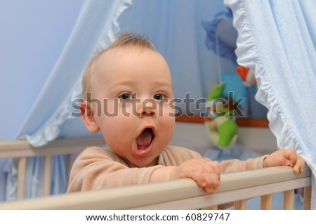 Happy infant in bed