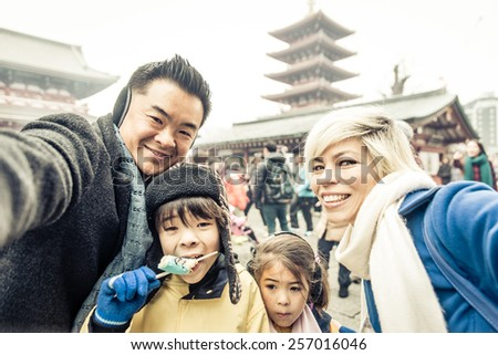 happy japanese family taking selfie in Asakusa, tokyo - stock photo
