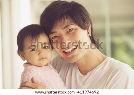 Happy japanese father and daughter