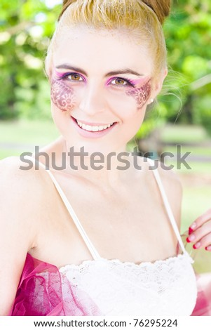 Happy Joyful And Smiling Ballerina Woman In Twenties With Abstract Lace Makeup In A Happy Creative Lifestyle People Portrait - stock photo