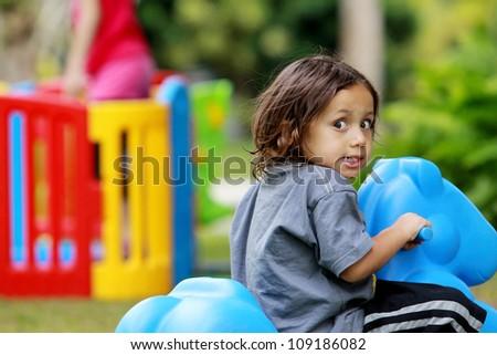 happy joyful boy having fun in the playground - stock photo