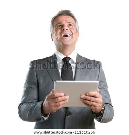 Happy joyful businessman cheering while working with his digital tablet isolated on white background - stock photo