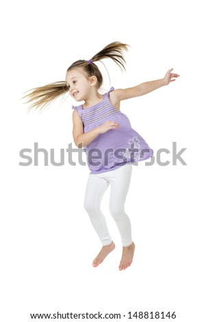 happy joyful child jumping high with real life facial expressions; isolated on white background with copy space for your text