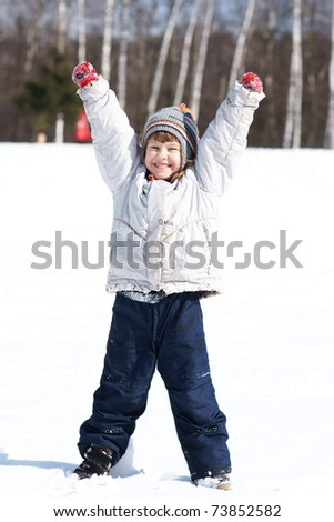 Happy joyful cute little girl, winter time - stock photo