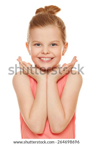 Happy joyful little girl smiling with hands near face, isolated on white background - stock photo