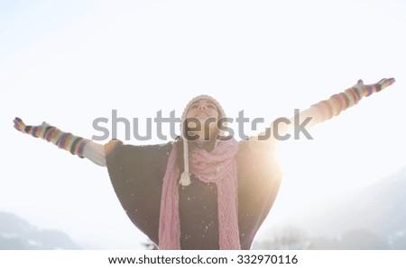 Happy joyful woman having fun outdoors, standing on the mountains - stock photo