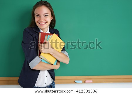 Happy joyful young girl likes read a books. Photo of student with books, creative concept with Back to school theme - stock photo