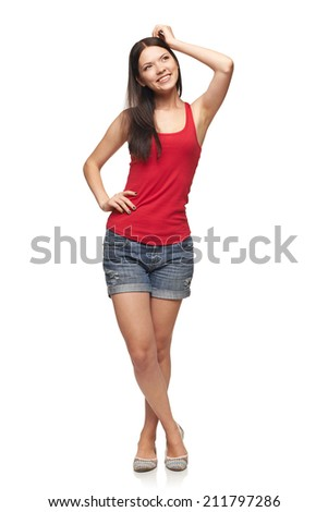Happy joyful young woman posing in full length looking away, over white background - stock photo