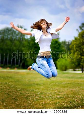 happy jumping girl - stock photo
