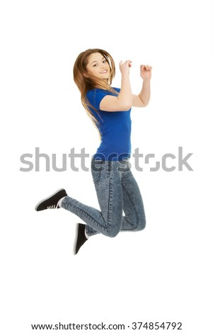 Happy jumping teenager. - stock photo