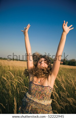 Happy jumping woman. Soft evening colors. - stock photo
