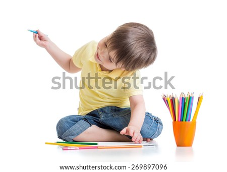 Happy kd boy drawing with pencils in album, isolated on white - stock photo
