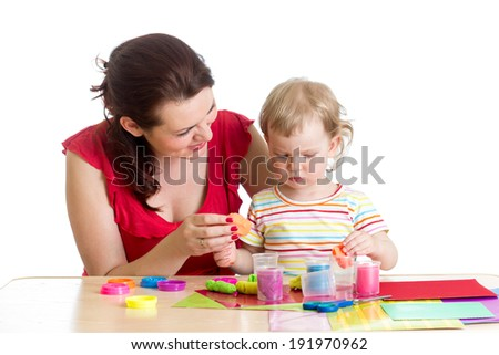 happy kid and mother play clay toy