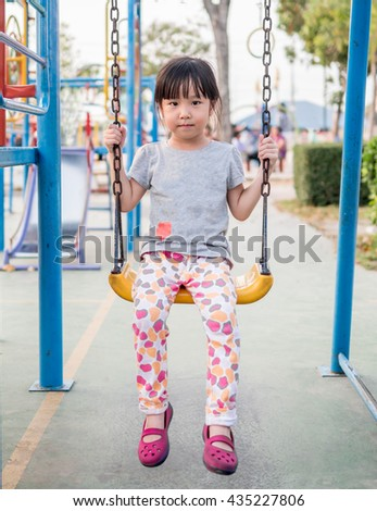 Happy kid, asian baby child playing on playground