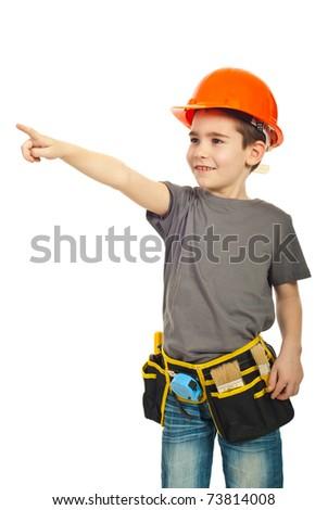 Happy kid boy with orange helmet pointing away isolated on white background - stock photo