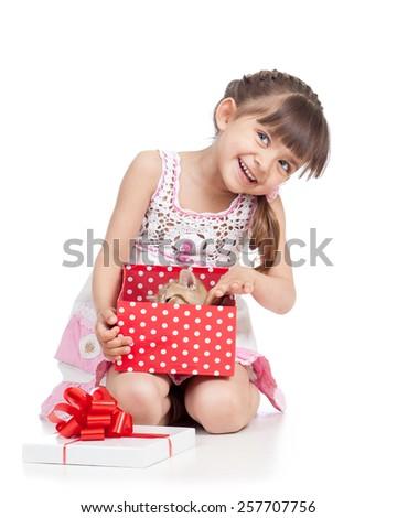 happy kid girl holding gift box with cat kitten - stock photo