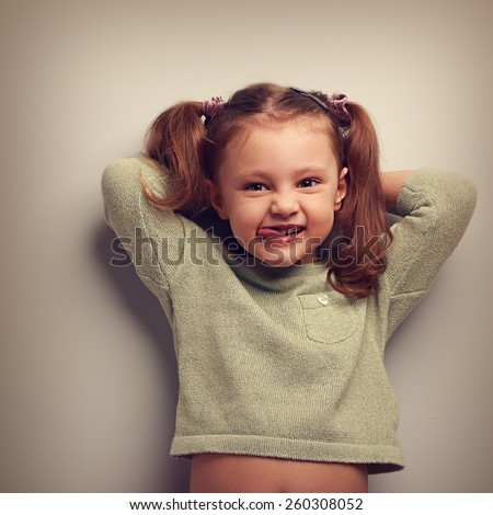 Happy kid girl with natural emotion in fashion blouse. Vintage closeup portrait - stock photo