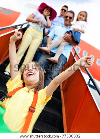 Happy kid going on holidays with his family by airplane - stock photo