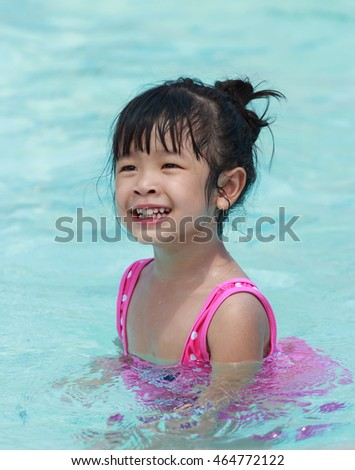Happy kid in the swimming pool.  Summer vacation concept.