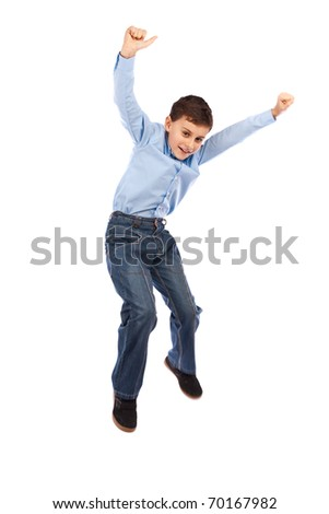 Happy kid jumping for joy, isolated on white background - stock photo
