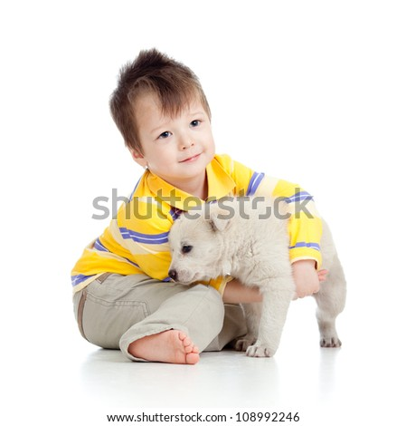 happy kid playing and hugging puppy dog - stock photo