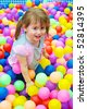 Happy kid playing in the colorful balls - stock photo