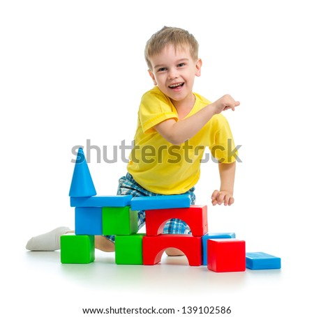 happy kid playing with colorful blocks isolated - stock photo