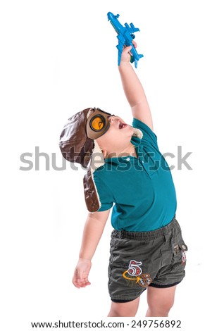 Happy kid playing with toy airplane . Asian boy with airplanes in hands isolated on white  - stock photo